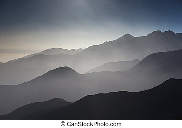 mountain view in morocco - misty view of hills and valleys...