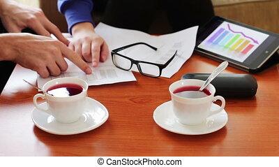 Business lunch between women and men.