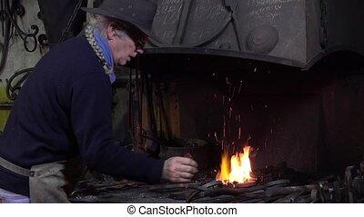 blacksmith artist in his workshop