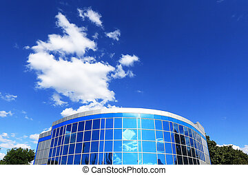 Office building on a background of blue sky with clouds