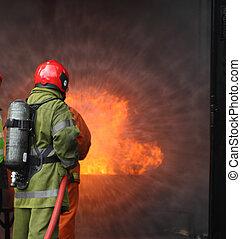 firemen fighting the fire