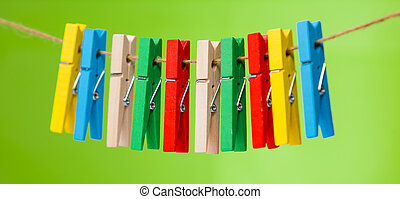 wooden clothespin hanging on rope. colorful clothespins. -...