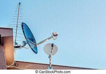 Satelite dish antenna on the house wall