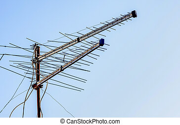 Tv antenna with blue sky in the background