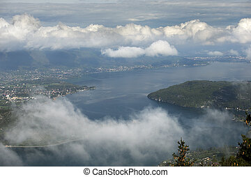 annecy lake - looking through the clouds down towards annecy...