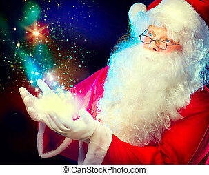 Santa Claus with magic gift in his hands