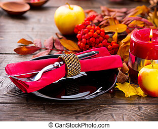 Thanksgiving wooden table served, decorated with bright...