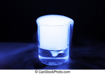 Chemical vapors - A chemical containing beaker producing...
