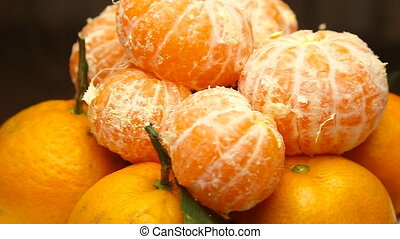 Rotating Tangerines with leaves