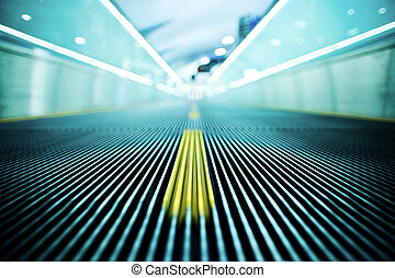 Abstract Airport - Moving escalator in an airport