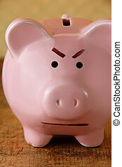 Angry Piggy Bank - Close up of an angry piggy bank