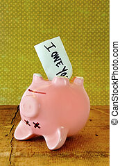 Dead Piggy Bank - Dead pigy bank with IOU note sticking out...