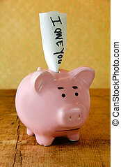 Worried Piggy Bank - Worried piggy bank with an IOU note.