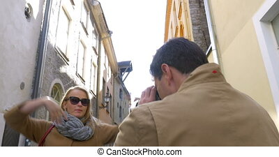 Man with Film Camera Shooting His Friend Outdoor