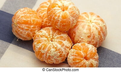 peeled tangerines rotate