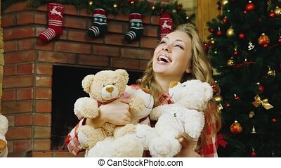 A beautiful girl with lots of teddy bears
