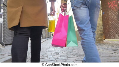 People Walking in Tallinn with Shopping Bags - Steadicam...