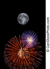 Full moon and fireworks exploding on clear night