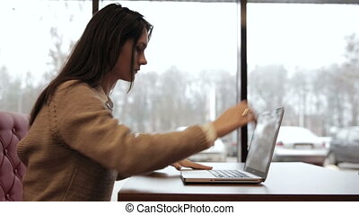 Woman comes, opens the laptop and starts working -...