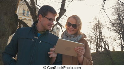 Couple with Tablet Walking in Tallinn - Steadicam shot of...
