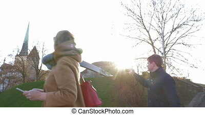 Adult Couple Travelling In Tallinn - Steadicam shot of a...