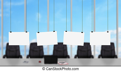 Four blank poster hanging on a rope in modern office