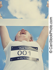 Finish Line Frontrunner - Fun Runner Throws Hers Arms Up At...