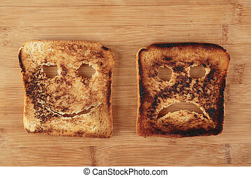 Happy and sad toast on a cutting board