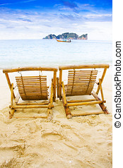 Holiday In Thai Paradise - Two Wooden Recliner Chairs Sit On...