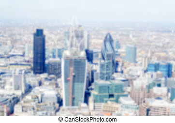 Defocused background of London City skyline Intentionally...