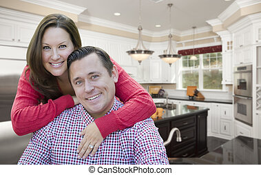 Happy Couple In Beautiful New Kitchen