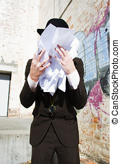 Paperwork Tears - Man Wipes His Face With His Scrunched Up...