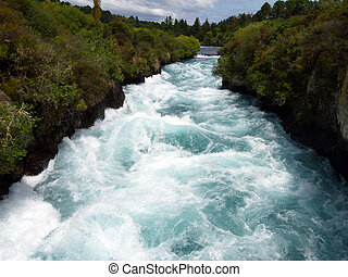 Huka Falls Rapids New Zealand - Sun lighting up a section of...
