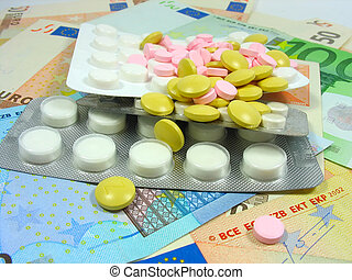white and colored drug pills in blisters over money