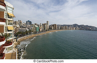 the coast and high rise skyline of benidorm seaside resort,...