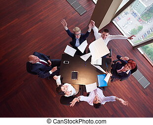 top view of business people group throwing dociments in air...