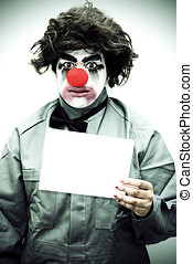Unhappy Clown Holding Sign - A Sign Of Unhappiness With A...