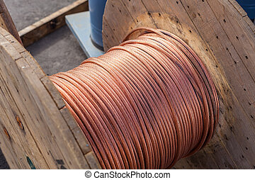 large spools of electric cable. horizontal shot