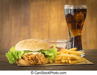 fast food set hamburger and french fries with cola on wood...