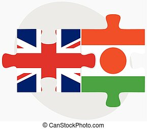 United Kingdom and Niger Flags in puzzle isolated on white...