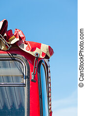Open Air Bus - Detail of red bus windows with tarpaulin...