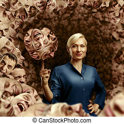 Woman holding men's faces - Businesswoman holding men's...