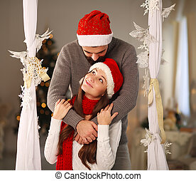 Happy Christmas couple in love at home