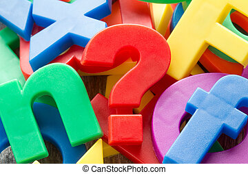 Letters with question mark - Pile of colorful plastic...