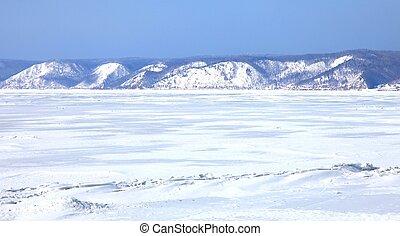 Frozen Lake Baikal in winter. Twilight.
