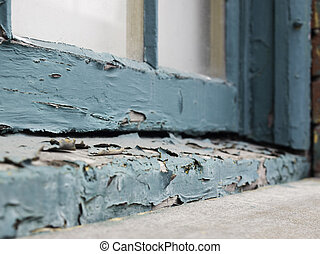 Peeling paint on window sill - Closeup of an old window sill...