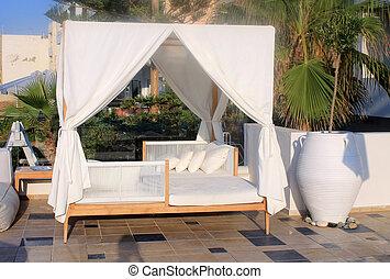 Beautiful sunbed on resort terrace, Crete, Greece