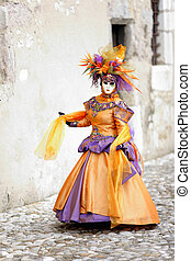 Walking in costume - Orange dress costume in medieval street...