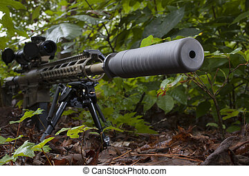 Silenced weapon - Camoflauge modern sporting rifle with a...