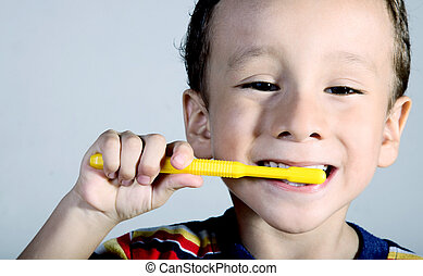 Oral Health - A child brushing his teeth Close up